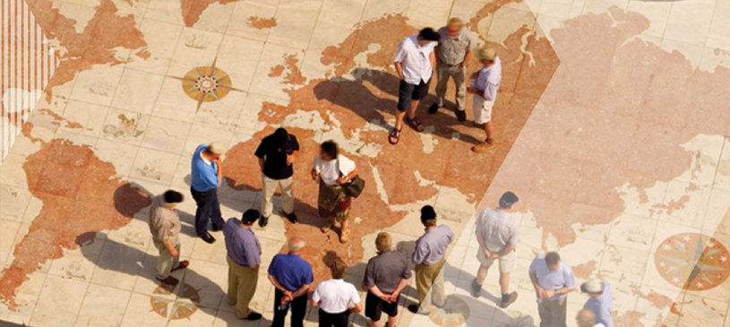 people standing on large globe